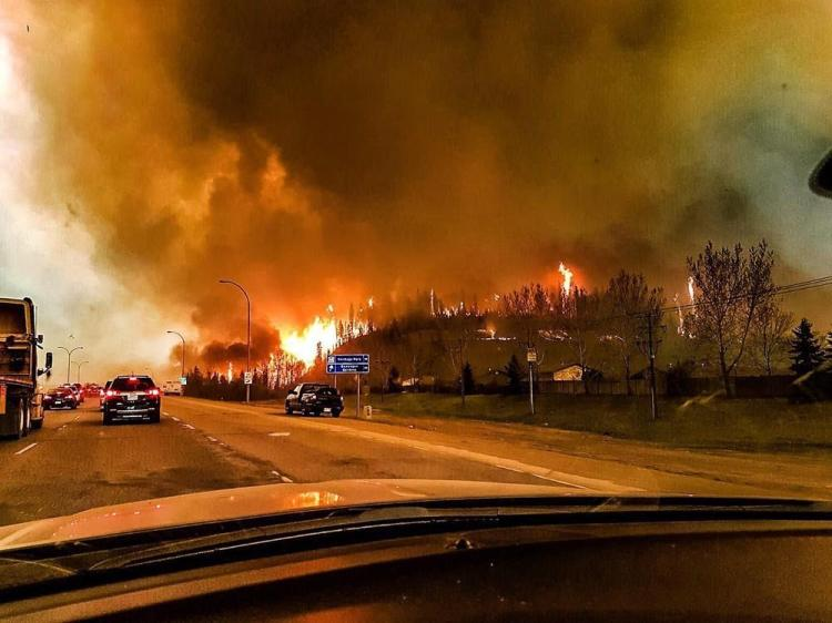 What is this insane wildfire in Fort McMurray really about?